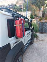 מיכל שטוח  אדום עם ברז גר'יקן  דלק או מים  10 ליטר להתקנה בצידי  הגיפ והרכב